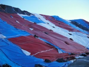 Image of different colored plastic tarps