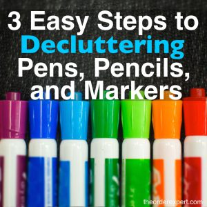 Image of dry erase markers in a row and the phrase, 3 Easy Steps to Decluttering Pens, Pencils, and Markers